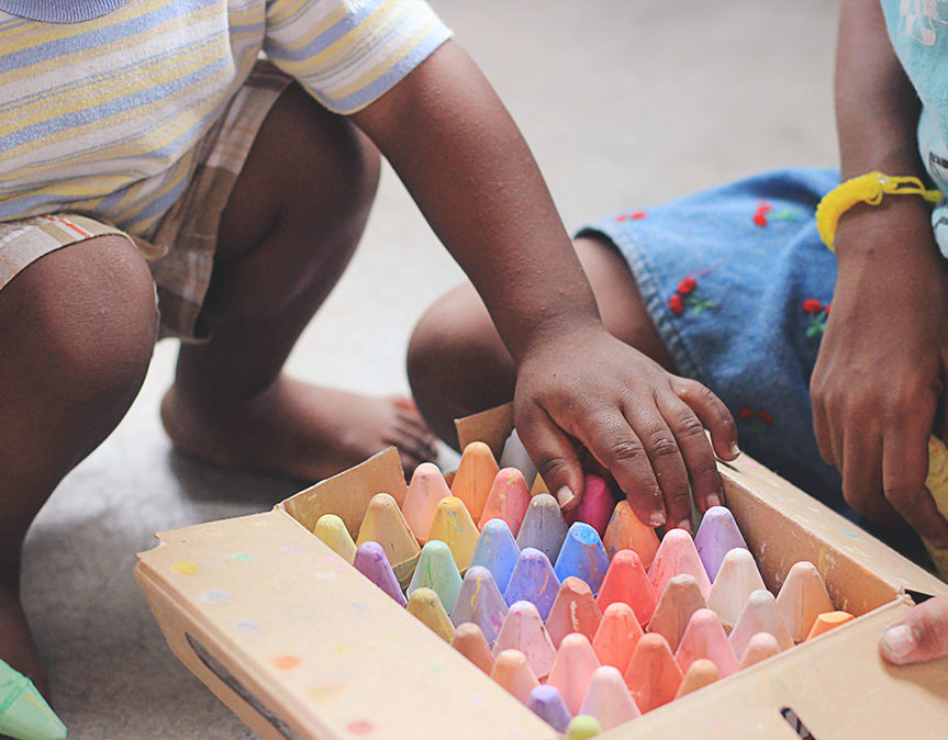 A child playing with crayons